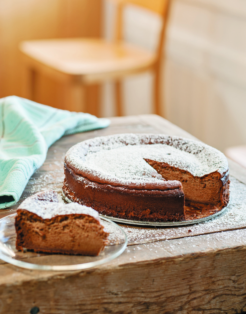 Flourless Milk Chocolate Cake This cake is a delicious, creamy, gluten-free dessert option. The fluffy texture comes from properly whipped egg whites, so don't skimp on that step.