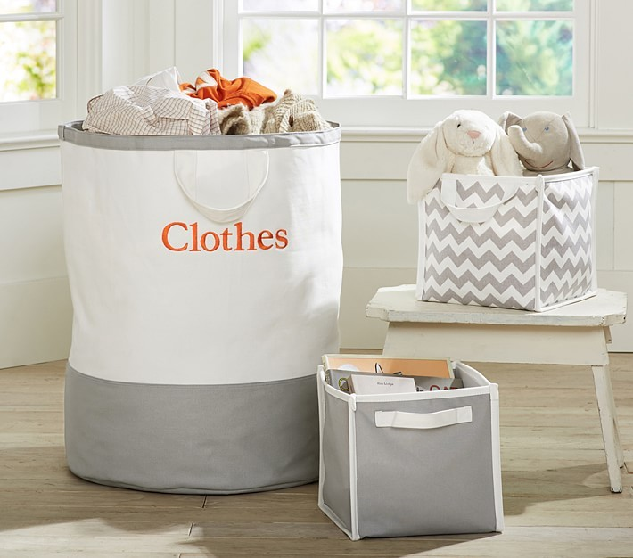 Harper collection helps you organize and tote everything from toys to laundry inside a medley of sturdy containers that feature bright colors and strong handles. Each piece folds easily so you can tuck it away when not in use.