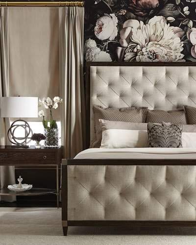 Wood-framed head and foot boards with inset button-less, tufted upholstered panel and top metal corner accents.