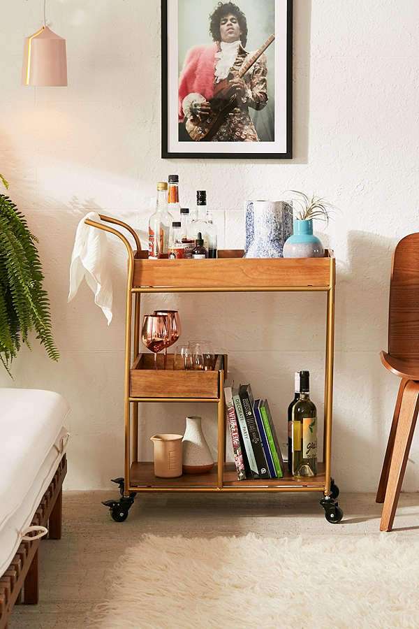 In richly varnished beech wood with a luxe golden frame, the Tatiana Bar Cart is the chicest watering hole on wheels around! Equipped with 3 shelves for storage and locking wheels for extra stability, use it alternatively for plants, beauty products or even vinyl + books.
