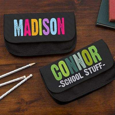 Keep school supplies organized in this All Mine! Personalized Pencil Case. Personalize with their first name printed across the front in 2 color options. Add 1 line message, displayed below the name, to be sure no one messes with their school supplies.